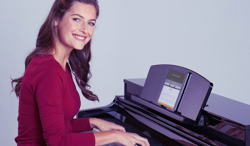 Učenje igranja na klavir s Flowkey